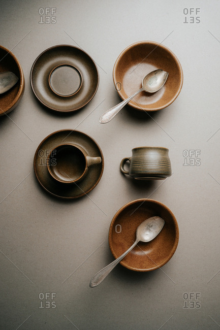 Brown mugs, saucers and bowls