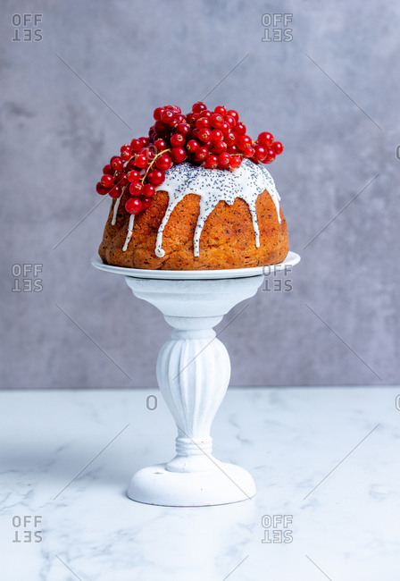 Cake with red currant on a cake stand