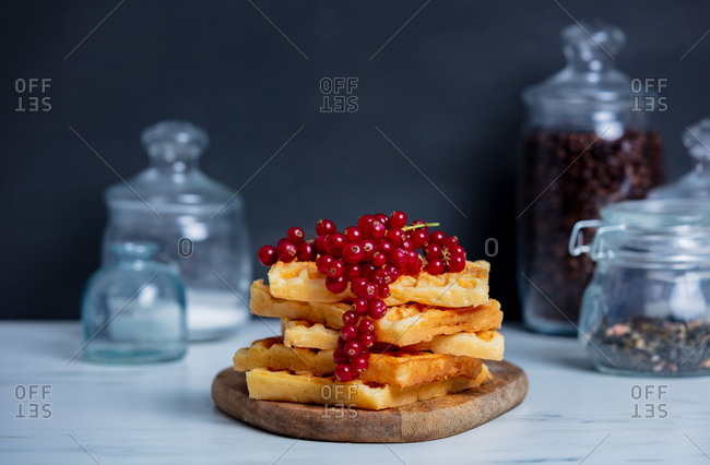 Traditional waffles and red currant on a table