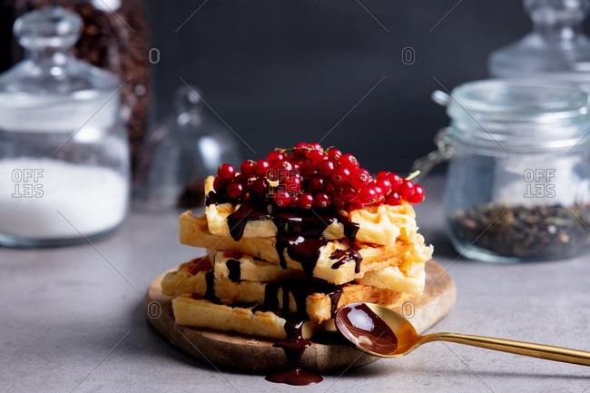 Traditional waffles topped with chocolate and red currant