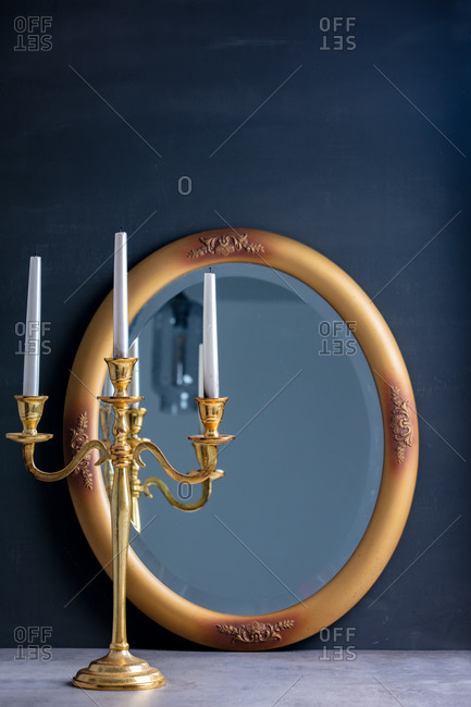 Golden candlestick and mirror