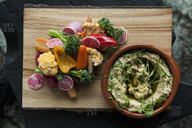 Overhead view of an appetizer of raw vegetables crudite with dip