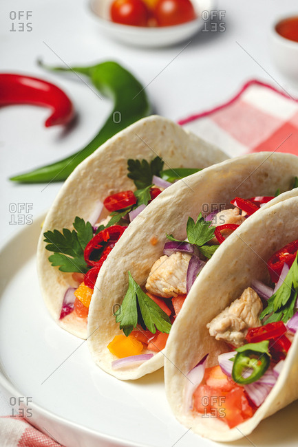 Homemade Mexican Tacos with fresh vegetables and chicken on white background. Healthy food .Burritos.