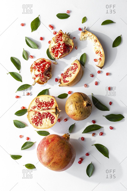 Fresh seasonal pomegranate from above on white background. Healthy food Detox. Flat lay