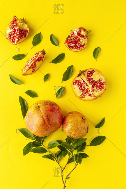 Fresh seasonal pomegranate from above on yellow background. Healthy food Detox. Flat lay