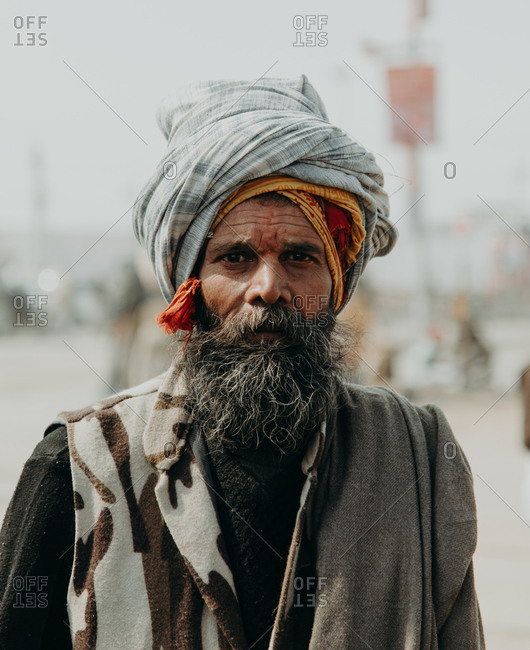 Allahabad, India - FEBRUARY, 2018: Close-up portrait of Elderly Indian man wearing traditional clothes against blurry background