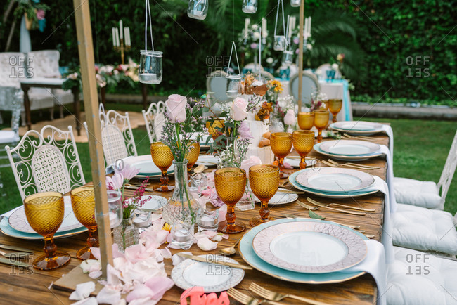 Wedding table decoration in rustic style placed outdoors