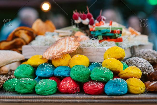 Assortment of delicious colorful sweets served on table on wedding candy buffet