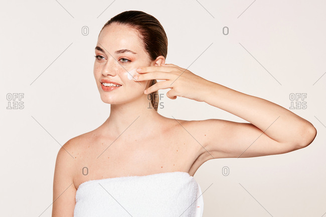 Amiable female taking care of face