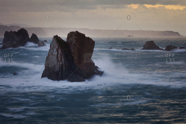 Picturesque majestic raging waters of bay breaking rocks on beach of Silence O Gaviero in Spain