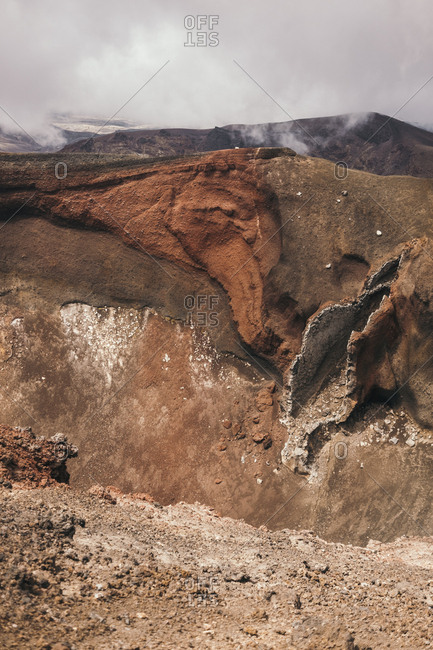 Rocky terrain with cloudy sky on background in Tongariro in New Zealand