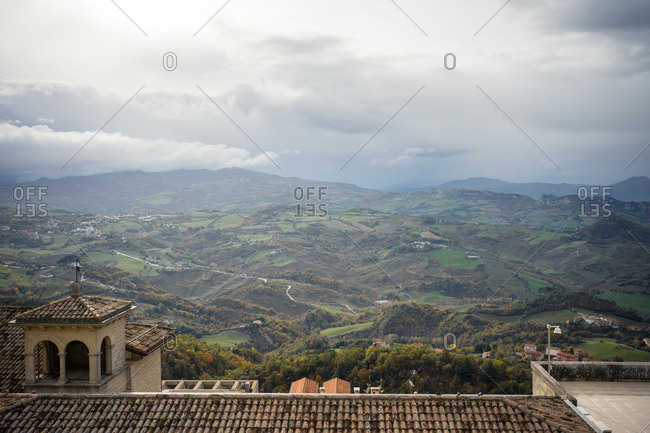 From above amazing landscape of green valley with gardens and roads from castle at top in San Marino, Italy