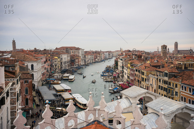 Venice, Italy - November 16, 2019: From above of beautiful city with ancient buildings and blue waterlines on cloudy weather