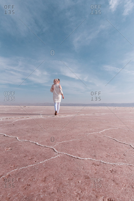 Thoughtful relaxed tourist enjoying unusual scenery of pink salt lake