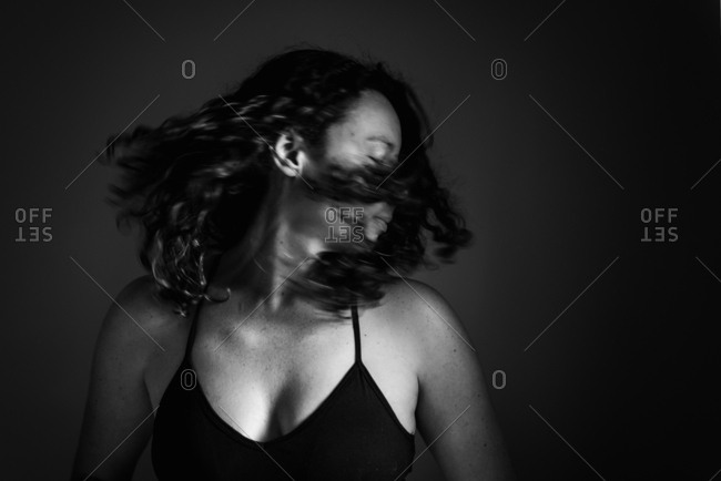 Brunette woman turning head with motion blur