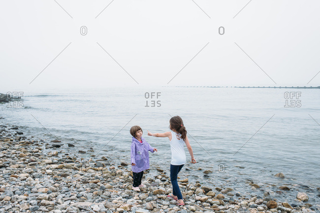 Girls playing at a foggy beach in Connecticut