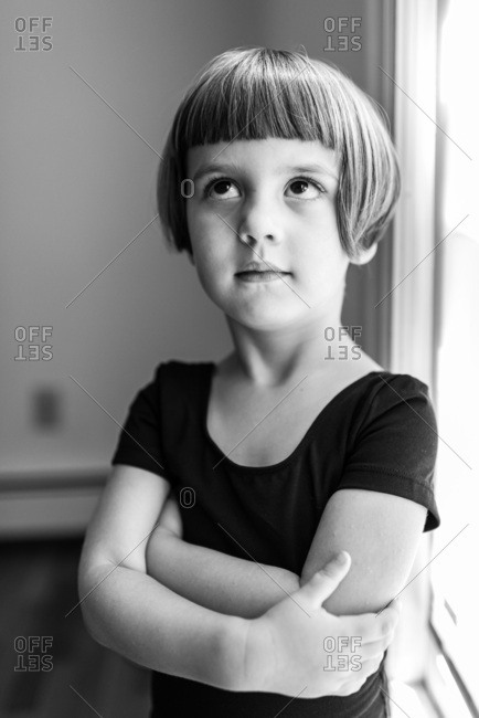 Black and white portrait of a preschool ballerina looking up