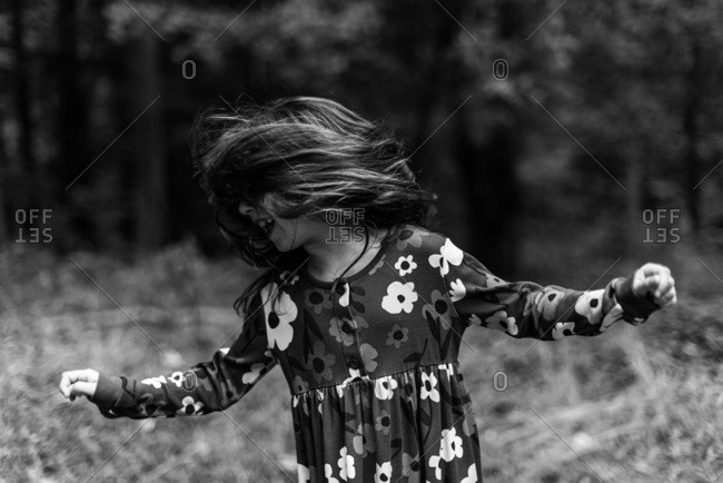 Girl shaking her hair in the woods