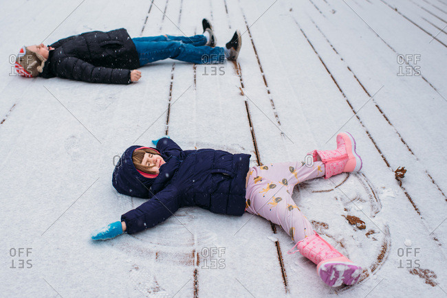 Kids making snow angels in the winter