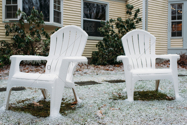 Icicles on Adirondack chairs in winter in Connecticut