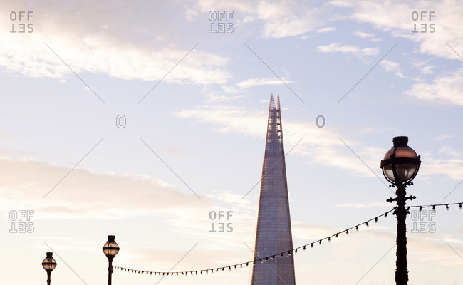 London, England - September 11, 2016: The embankment light posts and the Shard building at sunrise