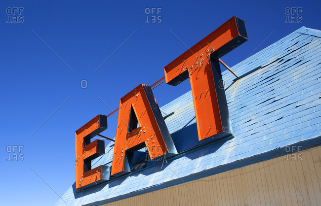 "Deserted cafe sign saying ""EAT"" on the Highway to Las Vegas in California, USA"