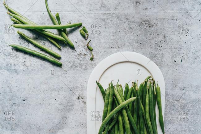 Fresh green beans on white plate