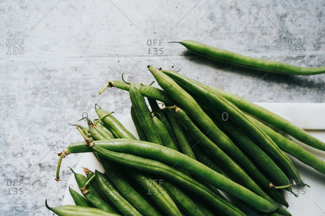 Close up of green beans on white plate
