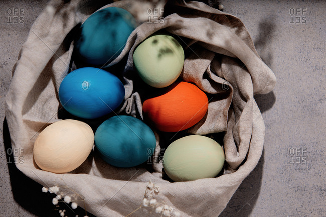 Colored Easter eggs wrapped in cloth