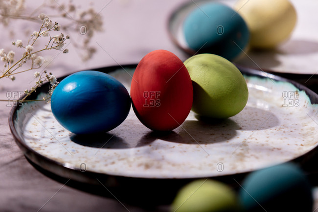 Colored Easter eggs in a plate
