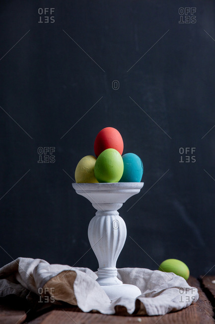 Colored Easter eggs on a stand