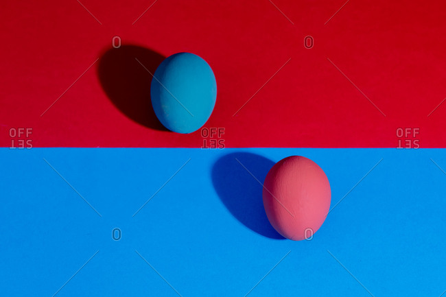 Two Easter eggs on red and blue background