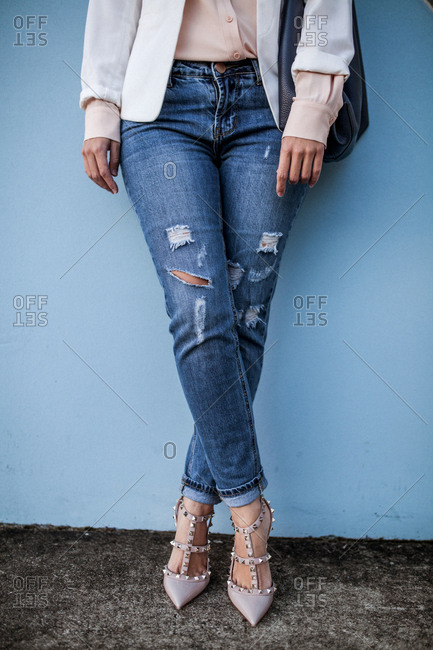 Woman wearing jeans and fashionable heels