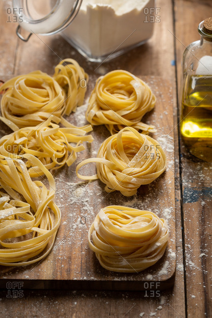 Fresh pasta being prepared on wooden surface