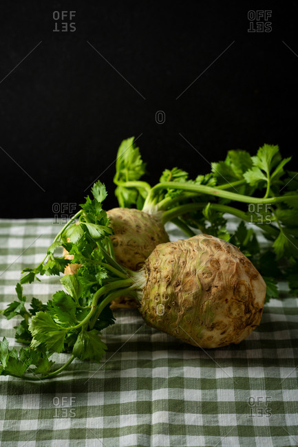 Fresh celery roots with black background