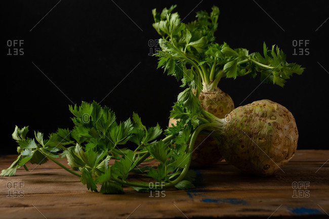 Fresh celery on rustic table