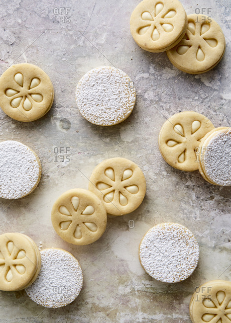 Lime sandwich cookies on stone surface