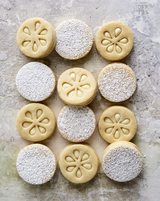 Key lime sandwich cookies on stone surface