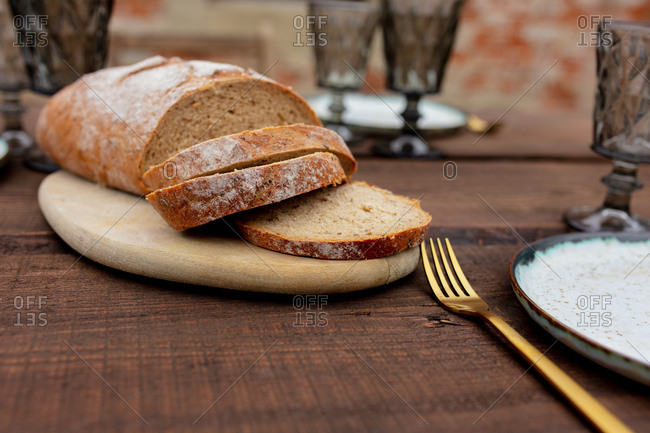 Village bread and glasses on a table in backyard