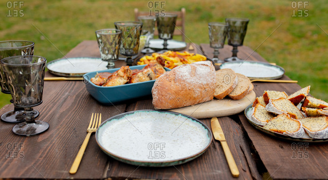 Bread, poppy pie and other food on a table in backyard