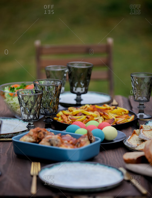 View at Easter dishes on a table in backyard