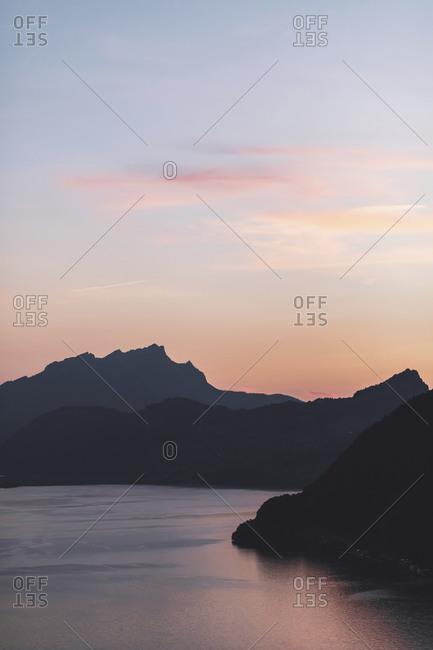 Switzerland- Gersau- Schwyz- Silhouettes of hills surrounding Lake Lucerne at summer dusk