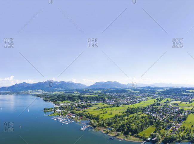 Germany- Bavaria- Prien am Chiemsee- Sky over coastal town with Chiemgau Alps in background