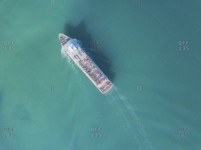 Germany- Bavaria- Aerial view of tour boat sailing across turquoise waters of Chiemsee lake