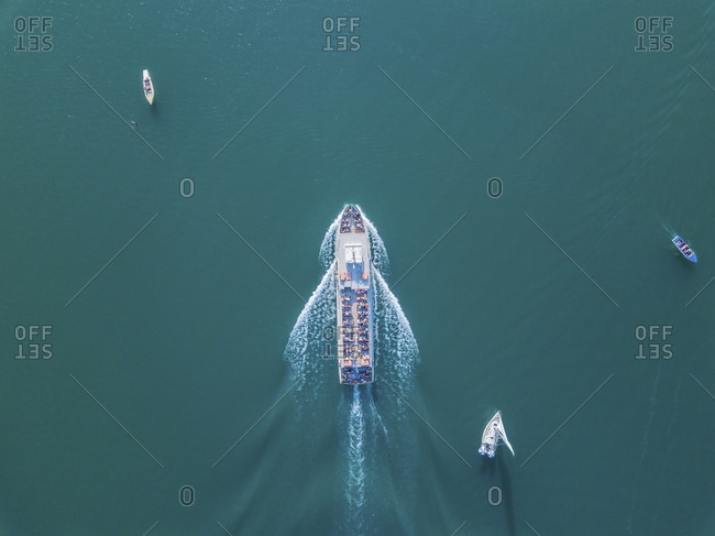 Germany- Bavaria- Aerial view of tour boat sailing between other boats across turquoise waters of Chiemsee lake