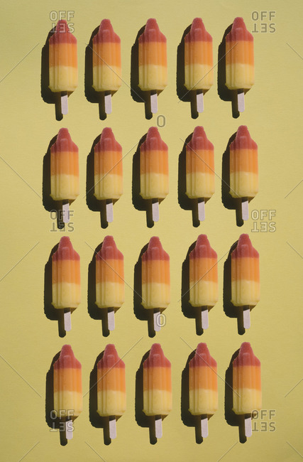 Directly above shot of flavored ice arranged on yellow background