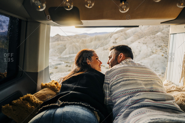 Young couple on a trip lying in a camper van at sunset- Almeria- Andalusia- Spain
