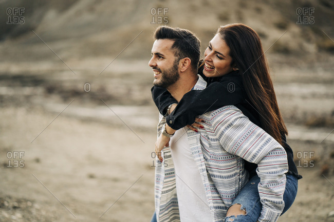 Cheerful young couple in desert landscape- Almeria- Andalusia- Spain