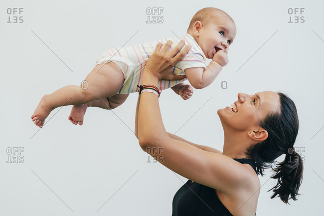 Young mother and baby during mother child gymnastics