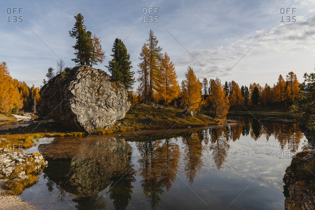 Autumnal mountain landscape reflected in the lake- Dolomites- Cortina- Italy